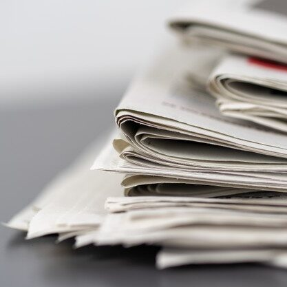 closeup-shot-several-newspapers-stacked-top-each-other_181624-16474