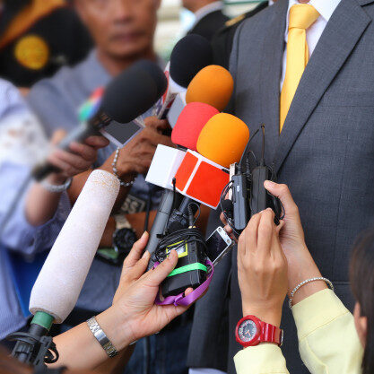 media-interview-conept-group-journalists-holdig-microphone-interviewing-vip_12892-44